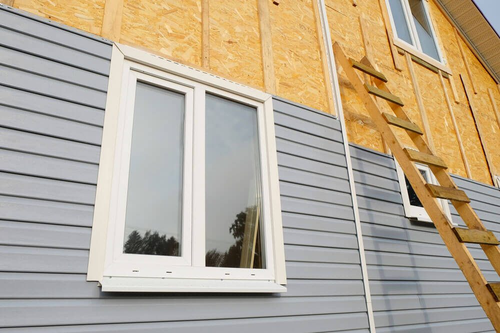 Climate controlled siding being installed