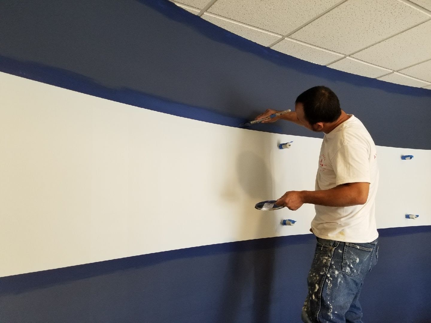 Painter painting a commercial interior