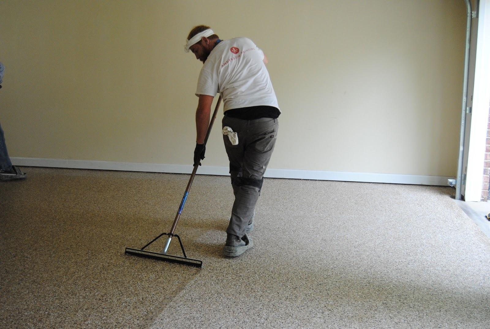 Contractor coating a floor in Raleigh