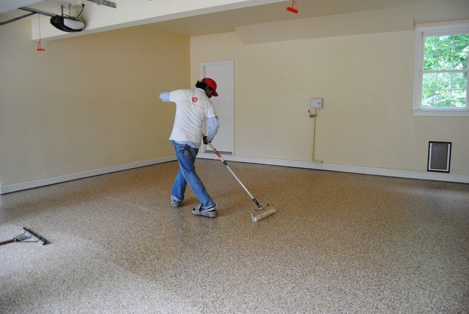 Anderson Painting contractor coating garage floor