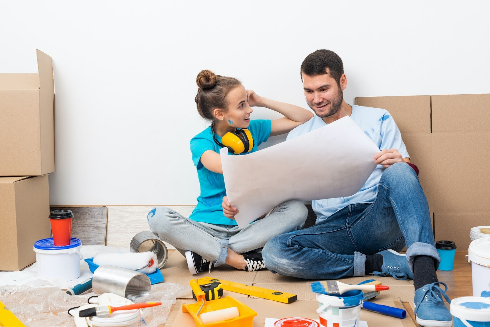 Couple looking at painting project plan