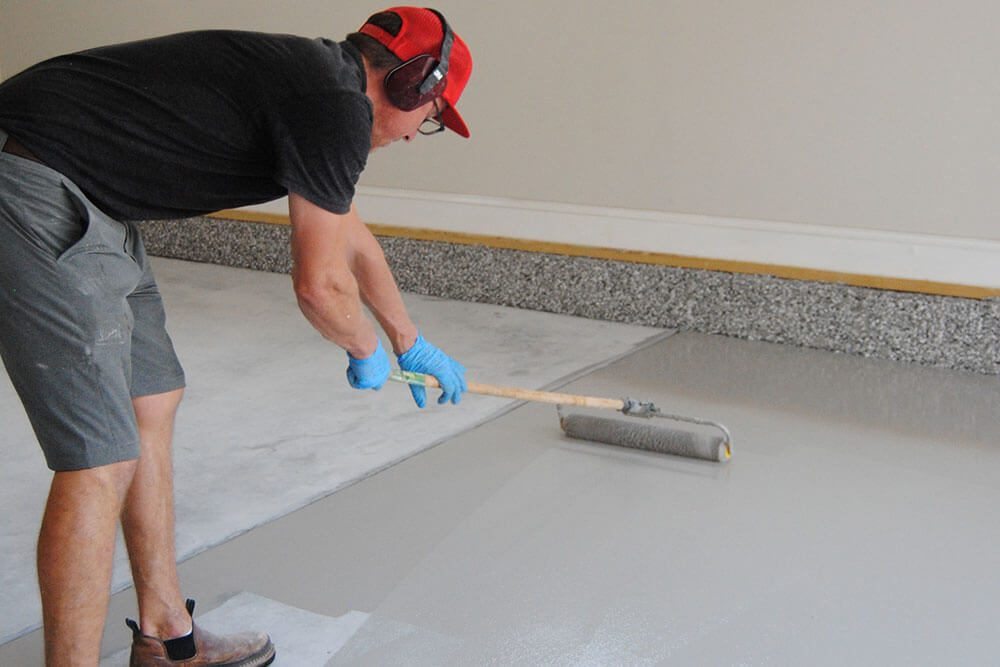 Anderson Painting concrete epoxy floor in garage