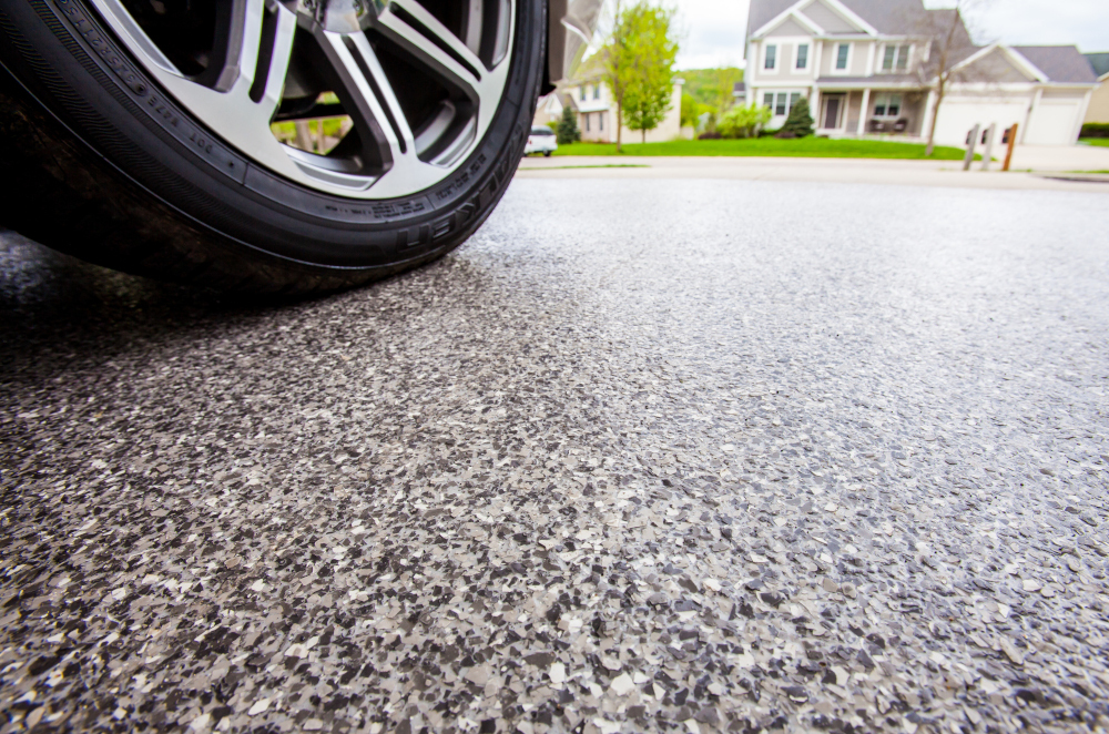 Concrete coated driveway with a car on it