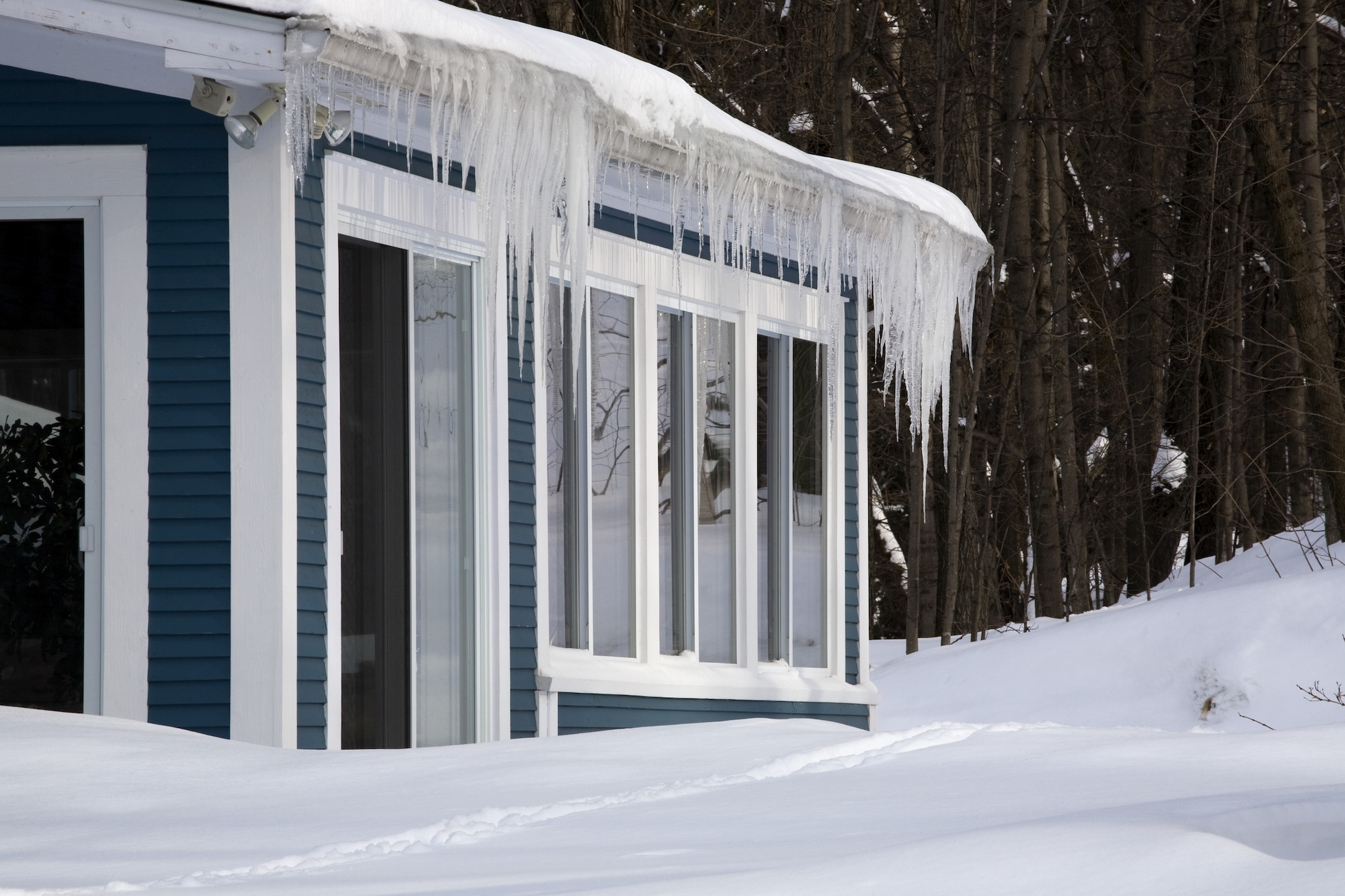 House with large snow fall around it