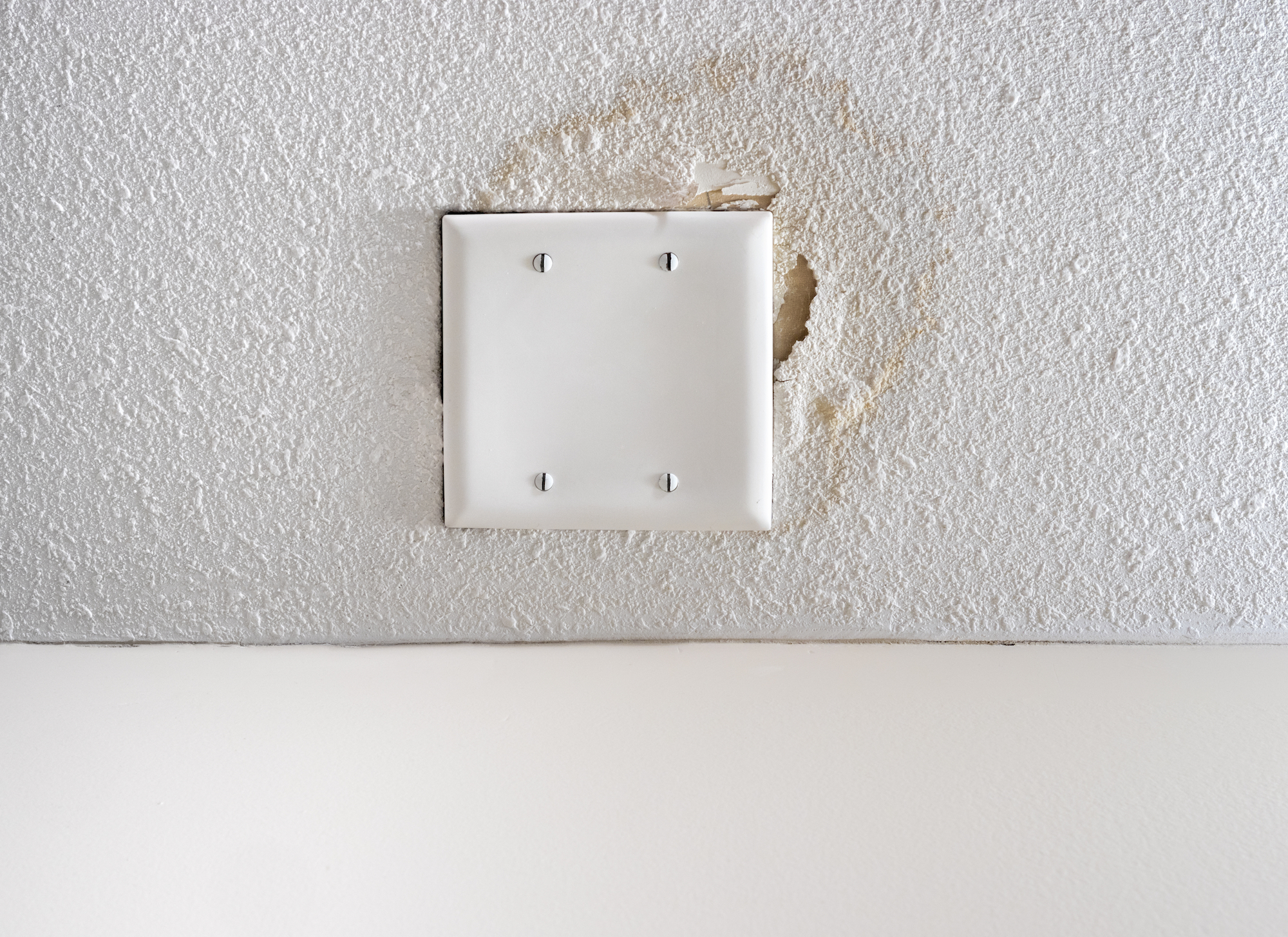 Worn out popcorn ceiling